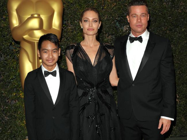 Angelina Jolie and Brad Pitt with their son Maddox attend the 2013 Governors Awards in Los Angeles. Picture: John Shearer/Invision/AP