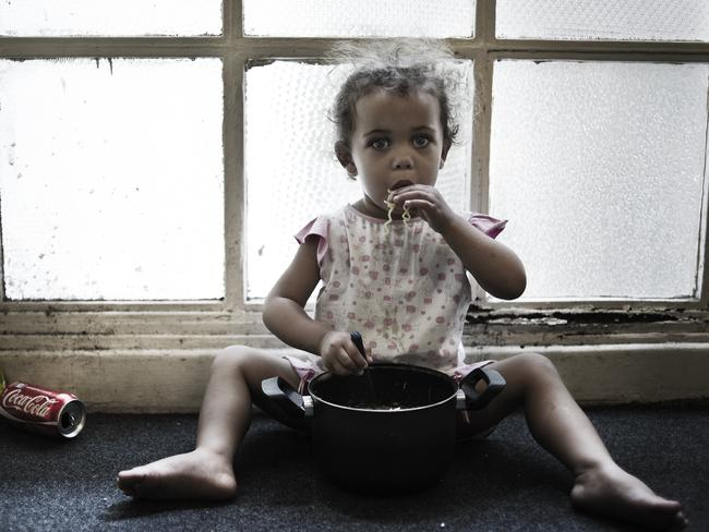 Nicolly, who was four in 2012, eating lunch in the hall of the 8th floor. Picture: Felipe Paiva/Newsmodo
