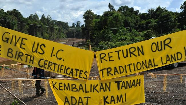 Banners on the main entrance near the first blockade camp of the proposed dam on the Baram River in Long Lama, Borneo. Picture: Mohd Rafsan