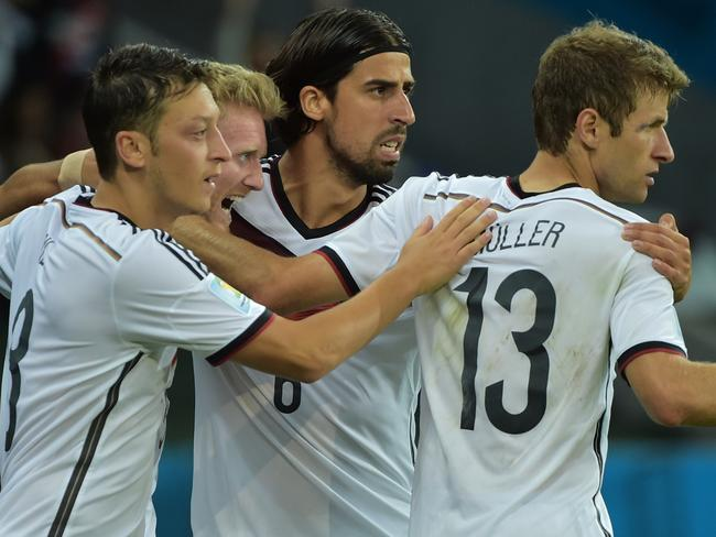 The Germans celebrate a goal against Algeria.