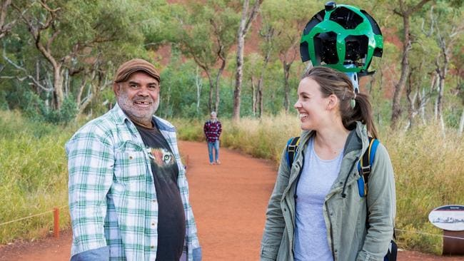 Traditional owner Sammy Wilson and Tourism NT spokeswoman Lindsay Dixon at Uluru, where they filmed footage for Google Street View. Picture: Jennifer Dudley-Nicholson/News Corp Australia