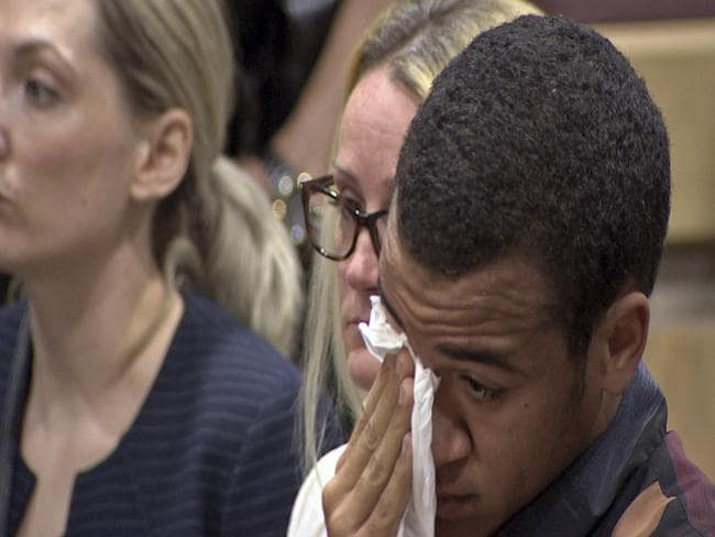 This frame grab provided by WSVN shows Zachary Cruz crying as his brother, Nikolas Cruz is arraigned at the Broward County Courthouse. Picture: WSVN/AP