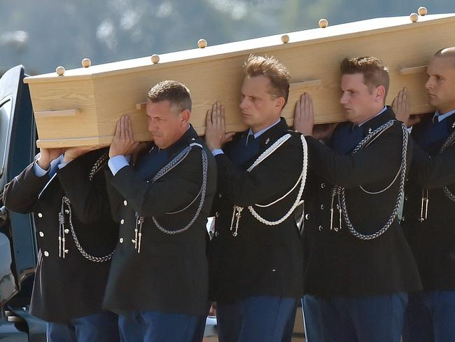 Operation Bring Them Home ... Dutch military personnel carry a coffin containing the remains of a victim of downed flight MH17, at Eindhoven Airbase. Picture: John Thys