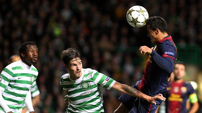 CHAMPIONS LEAGUE: Barcelona's Alexis Sanchez, right, has a header toward's goal past Celtic's Mikael Lustig at Celtic Park, Glasgow. Picture: Scott Heppell