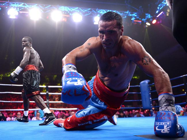 Mundine is floored by Joshua Clottey.