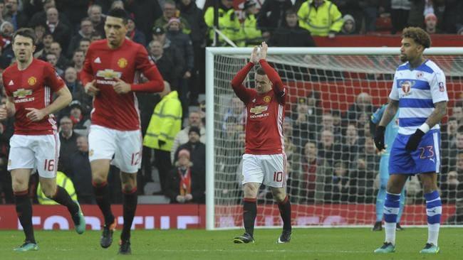 Rooney celebrates scoring.