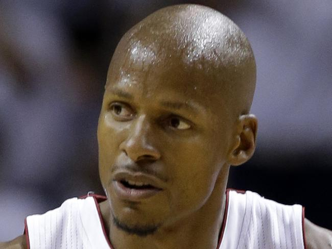 "FILE - In this May 30, 2014, file photo, Miami Heat guard Ray Allen gestures after scoring a three-point basket during the first half of Game 6 in the NBA basketball playoffs Eastern Conference finals against the Indiana Pacers, in Miami.  Retired NBA star Ray Allen believes he is a victim of ""catfishing,"" and has asked a court to throw out a case where he is accused of stalking someone he met online. Allen filed an emergency motion in Orange County, Florida, on Tuesday,Nov. 21, 2017, one day after Bryant Coleman told the court he is being stalked by the 10-time All-Star and two-time NBA champion. (AP Photo/Lynne Sladky, File)"