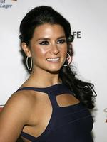 QUEEN of the track, NASCAR driver Danica Patrick arrives at the Sports Illustrated 2008 Swimsuit Issue launch party in New York. Picture: Stuart Ramson
