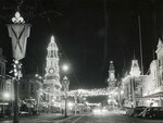 The Adelaide Town Hall clock lit up in King William St in the 1950s.