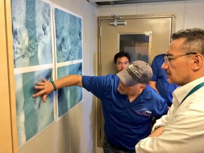Not giving up ... a briefing on-board the survey ship Go Phoenix. Picture: Twitter