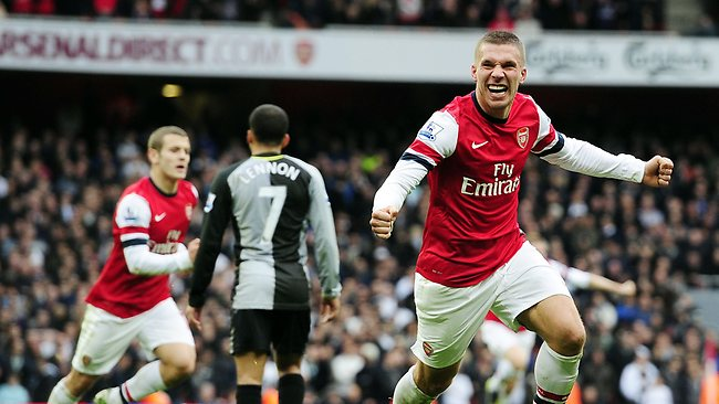 Arsenal's Lukas Podolski celebrates scoring their second goal in the English Premier League win over Tottenham Hotspur at the Emirates Stadium. PictureL Glyn Kirk