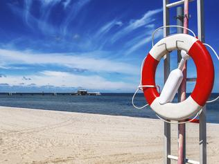 ESCAPE: MEDICARE OVERSEAS .. Elisabeth Knowles story .. life buoy on a beach. Picture: iStock