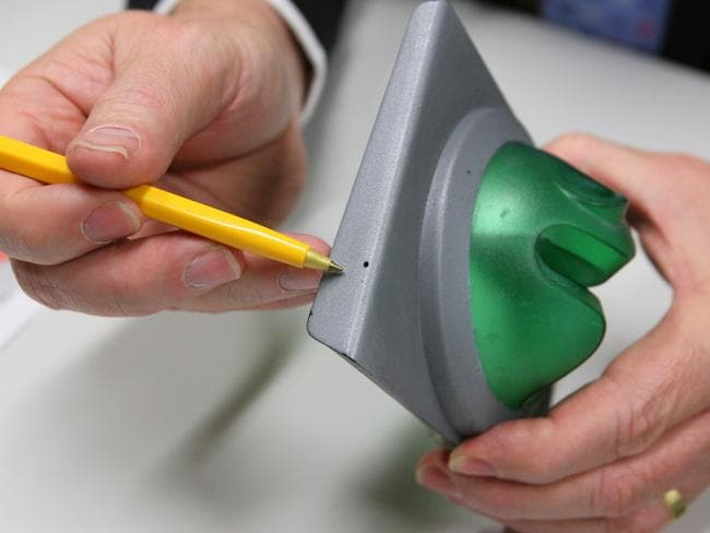 An Australian example of a card skimming device. The pin hole camera was planted to record victims' PINs.