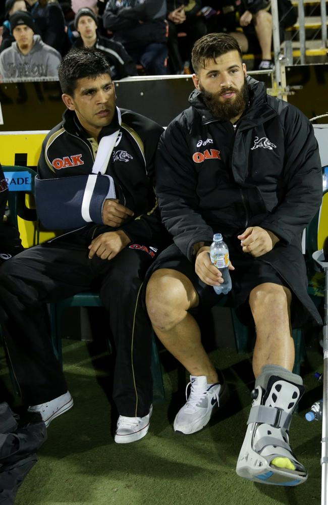 Panther's Tyrone Peachey and Josh Masour injured on the sideline.