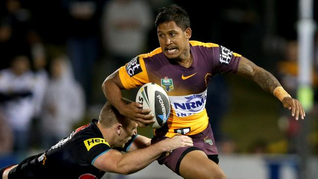 Broncos Ben Barba attempts to bust the tackle of Panther's Bryce Cartwright.