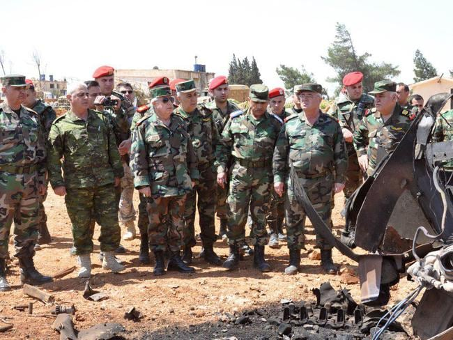 A handout picture released by the official Syrian Arab News Agency reportedly shows Syrian Armed Forces' chief of staff, Ali Abdullah Ayyoub (C-L), visiting Shayrat airfield. Picture: AFP