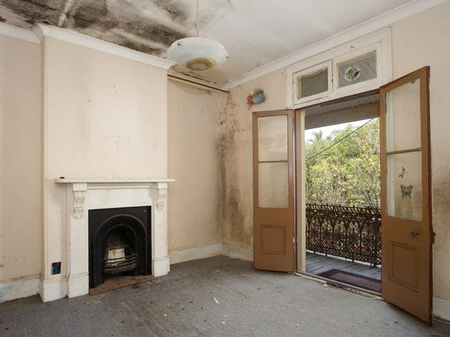 Mouldy walls and carpets at 46 Boronia St, Redfern.