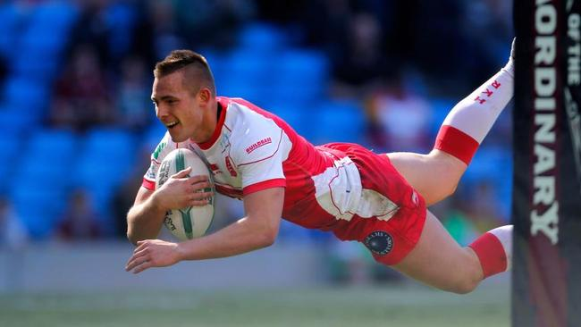 Greg Eden of Hull KR dives into score a try.
