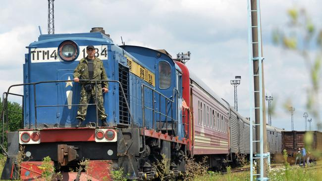 Bodies arrive ... the train carrying the 280 bodies recovered from the downed Malaysian flight MH17 arrives at the Malyshev Plant, in the government-held Ukrainian city of Kharkiv. Picture: Sergey Bobok