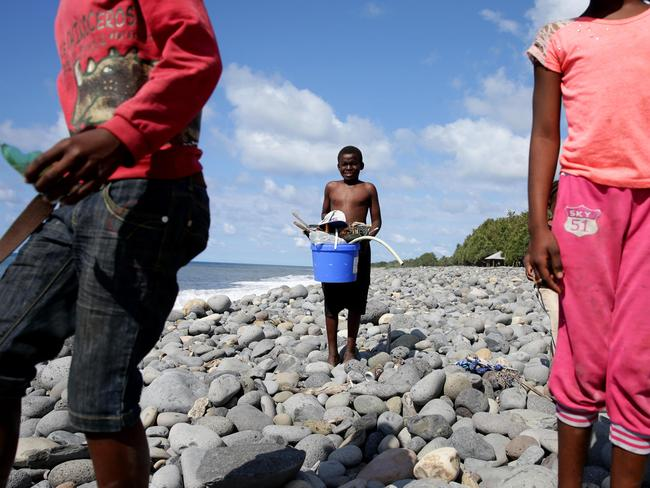 Sea urchins ... these kids spend every day scavenging the beach where what is believed to be a part of MH370 washed up, yet no officials have questioned them about previous finds. Picture Cameron Richardson