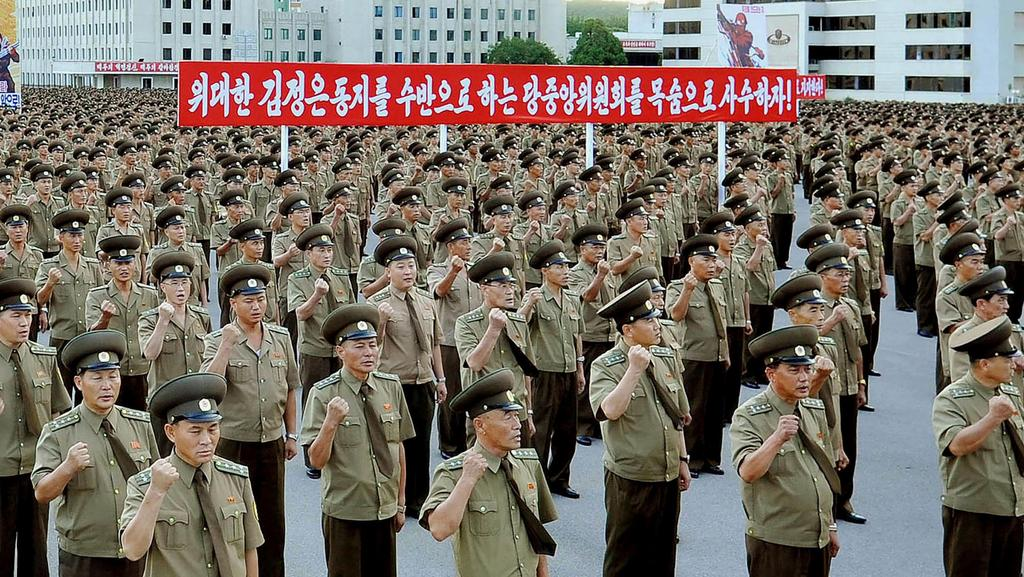 Service personnel of North Korea's Ministry of People's Security at a rally in support of its stance against the US, in Pyongyang. Australia would immediately support the US in the event of a strike. Picture: AFP
