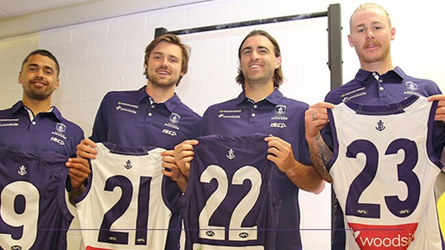 Fremantle's recruits with their new jumpers.