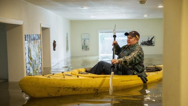 Lorin Doeleman uses a kayak to check her flooded home. Picture: Santiago Mejia/San Francisco Chronicle via AP