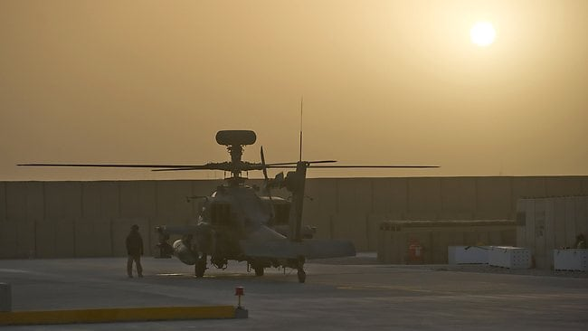An AH-64D Longbow Apache helicopter waits for an emergency call at Bastion Airfield in Camp Bastion. Picture: LEON NEAL