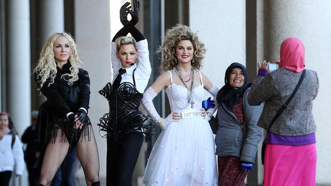 Fans stop to take photos as Madonna pops into town.