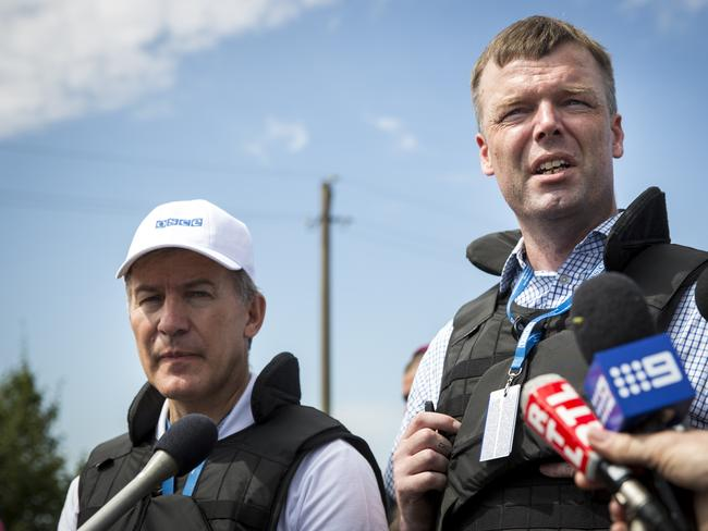 Restricted access ... Alexander Hug, right, and Michael Bociurkiw from monitoring group Organisation for Security and Cooperation in Europe (OSCE) speak to journalists after inspecting part of the wreckage of Malaysia Airlines flight MH17.