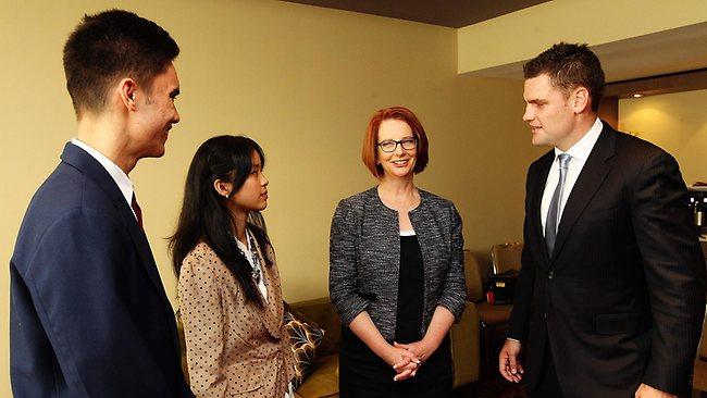 Julia Gillard meets with former NRL player Corey Payne and students Elaine Yeo, 18 and Paulo Greaves, 17 from Fairfield High School. Picture: Craig Greenhill.