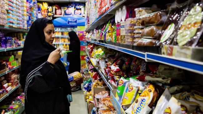 Women browse food products in a grocery store in Jeddah, Saudi Arabi. Photo: Bloomberg via Getty