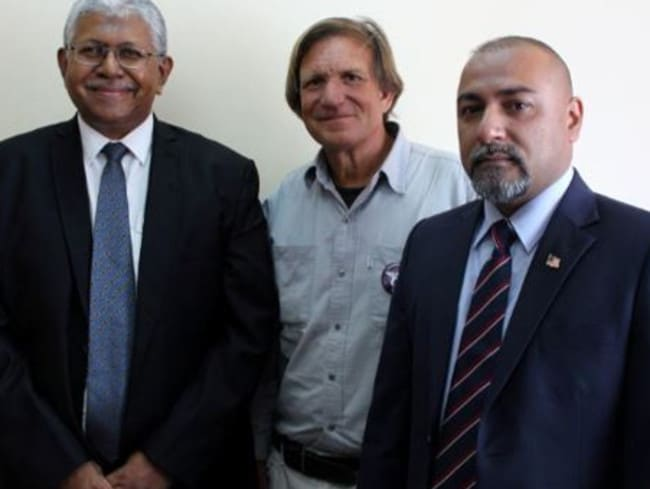 From left: Malaysian investigator Aslam Khan, MH370 hunter Blaine Gibson and Malaysian Consul Zahid Raza, who was murdered last week, pictured at the Ministry of Transport in Madagascar last December.