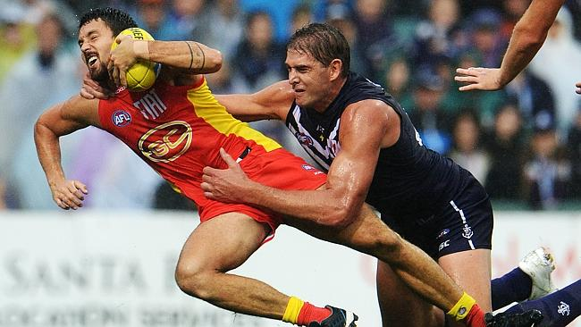 Sandilands comes to grips with former teammate Greg Broughton in the wet at Patersons Sta