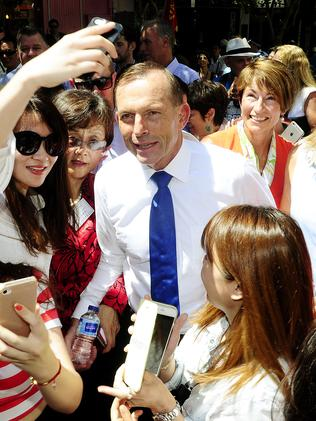Selfies all round ... Tony Abbott is mobbed by crowds on a walk through Chinatown. Picture: Damian Shaw