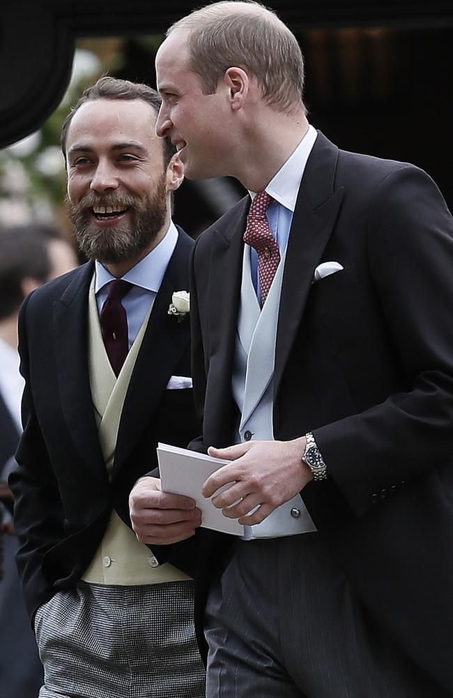 Wills talks to James Middleton as they file out into the church grounds.