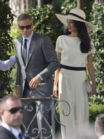 George Clooney and Amal Alamuddin leave the Cipriani hotel in Venice, Italy on Monday, September 29th 2014. Picture: AP