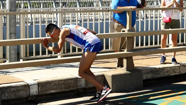 Hawkins pitches forward and lurches almost into the guardrail as his collapse begins. Picture: Cameron Spencer/Getty