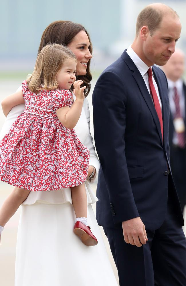 Even William's tie was tied into the family's outfit theme of red, white and navy. Picture: AFP