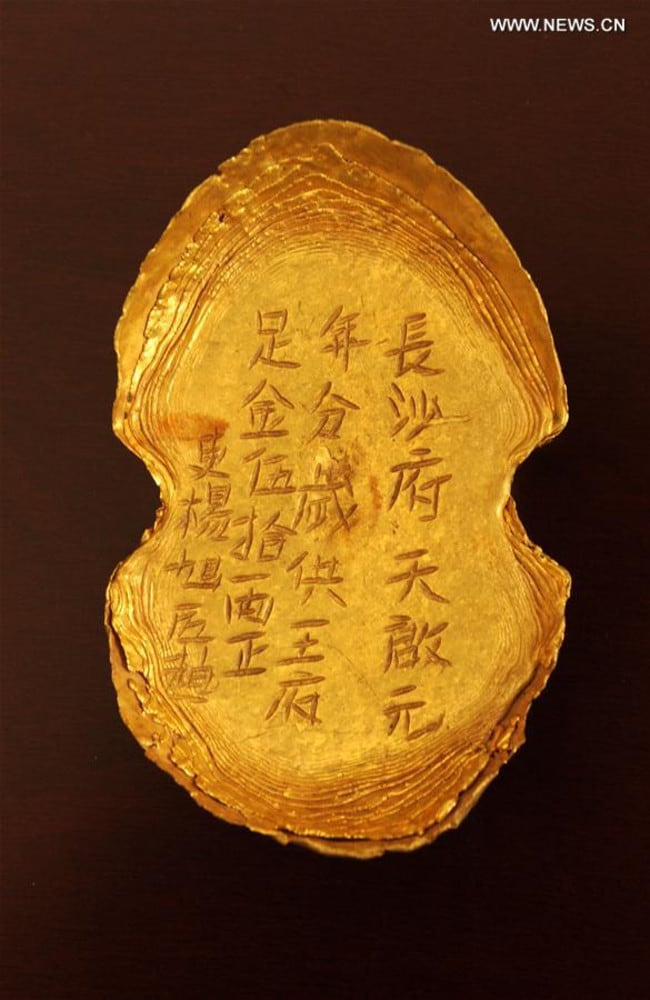 A golden ingot that sank to the bottom of a river in Sichuan Province over 300 years ago. Picture: Xinhua/Chen Xie