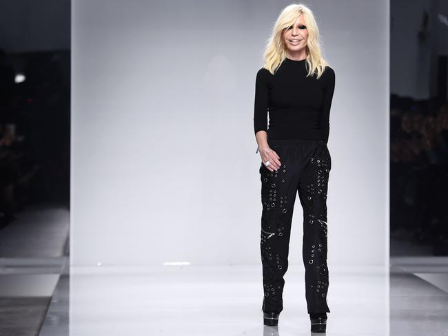 Visionary ... Donatella Versace takes the catwalk after her collection was shown. Picture: AFP