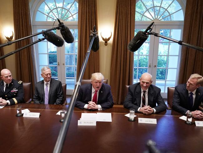 Donald Trump, flanked by Defense Secretary James Mattis (left), and Chief of Staff John Kelly (right), meets with senior military leaders in the Cabinet Room of the White House. Picture: Mandel Ngan/AFP