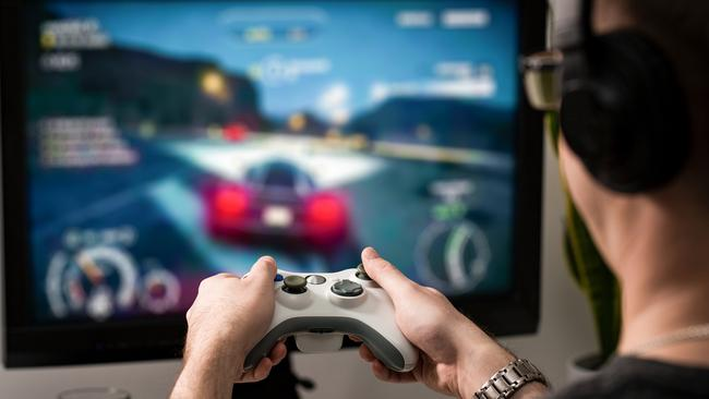 A number of reports have revealed that people, particularly men, are gaming more and working less. Picture: iStock