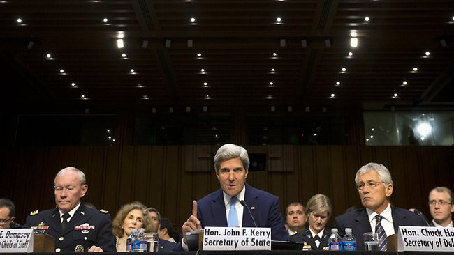 Secretary of State John Kerry, center, flanked by Joint Chiefs Chairman General Martin E. Dempsey, left, and Defence Secretary Chuck Hagel, testifies on Capitol Hill in Washington during a Senate Foreign Relations Committee hearing on Syria. (AP Photo/Jacquelyn Martin)