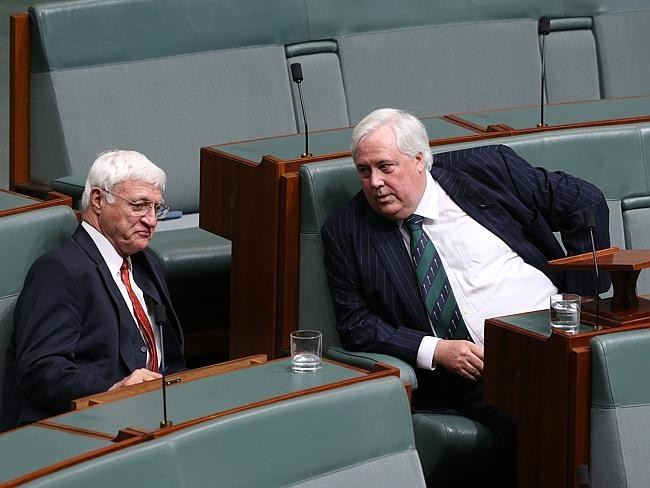 Clive Palmer speaks with Bob Katter after delivering his maiden speech. Picture: Ray Strange