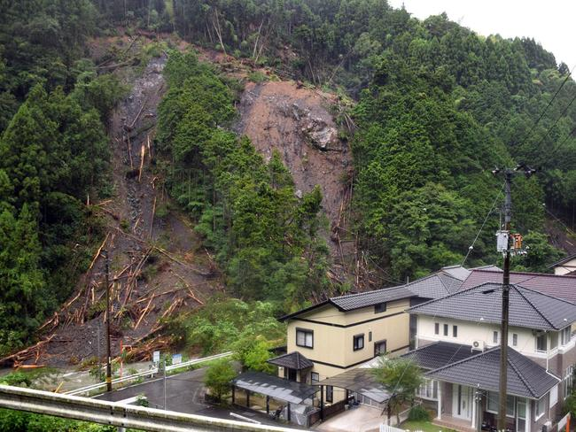 Drenched ... A landslide next to a group of houses was caused by heavy rains as Typhoon Halong approached Kochi yesterday. Source: AFP