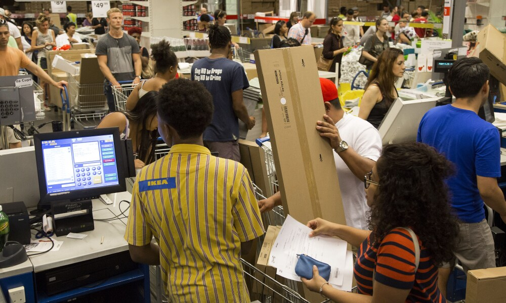 Customers checkout at an Ikea store in the Brooklyn borough of New York, U.S., on Saturday, Sept. 19, 2015. The U.S. Census Bureau is scheduled to release monthly durable goods data on Sept. 24. Photographer: Michael Nagle/Bloomberg