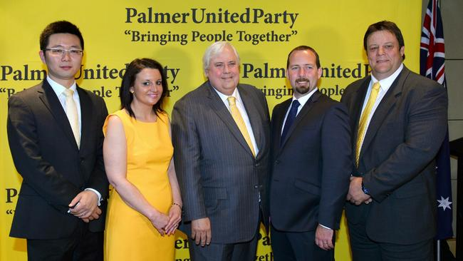 United we stand, sort of ... Jacqui Lambie with Clive Palmer and fellow PUP senators Dio Wang and Glenn Lazarus (in fetching yellow ties) plus Australian Motoring Enthusiast Party's Senator Ricky Muir.
