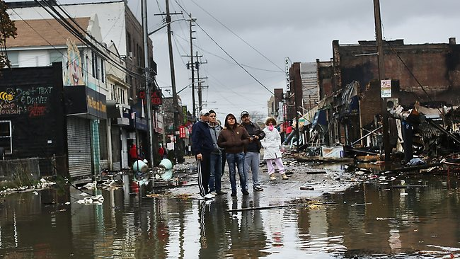 People look at homes and businesses destroyed during Hurricane Sandy in the Rockaway section of the Queens borough of New York City. Picture: Spencer Platt