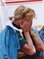 Gillian Rolton covers her face after falling at the Gawler Thrre-Day Event in 1993.